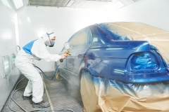 worker painting auto car body